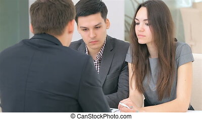 Couple consults about their business project, at the business analyst