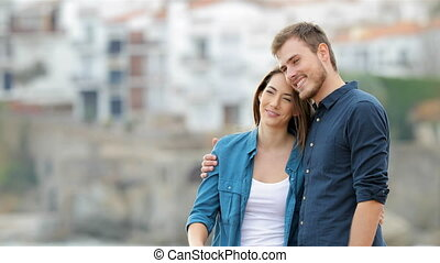 Couple contemplating and pointing horizon in a town