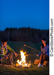 Couple cook by bonfire romantic night countryside - Young...