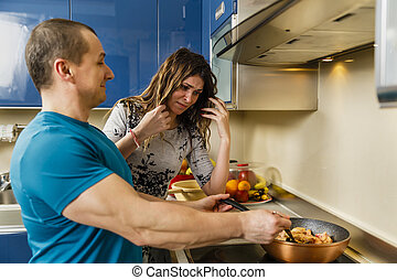 Couple cooking at home, wife not impressed with husband's cooking results