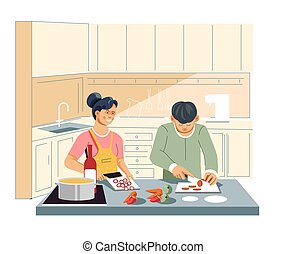 Couple cooking food at kitchen cutting vegetables and sausage
