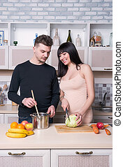 Couple cooking food