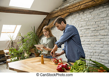 Couple cooking in the modern kitchen