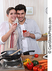Couple cooking together and drinking wine