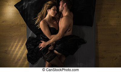 Couple cuddling after sex