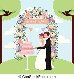 couple cutting wedding cake arch flowers save the date