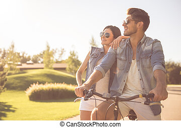 Couple cycling in park