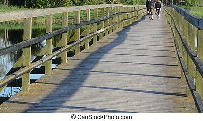 couple cyclist bridge