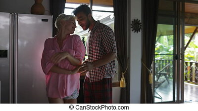 Couple Dance In Kitchen Happy, Young Cheerful Man And Woman Morning In Modern Apartment