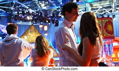 couple dances on New Year TV show in studio, closeup