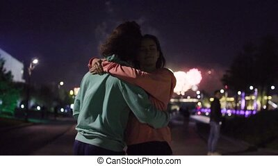 Couple dancing against fireworks in night city