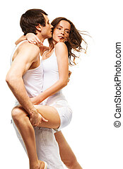Couple dancing and kissing - Attractive couple in intimate...
