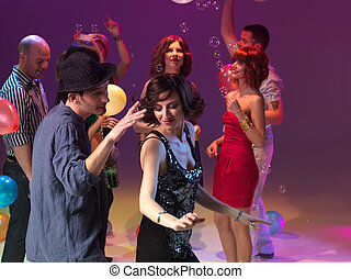 couple dancing and partying, together with friend