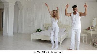Couple dancing bedroom, mix race man woman playing having...