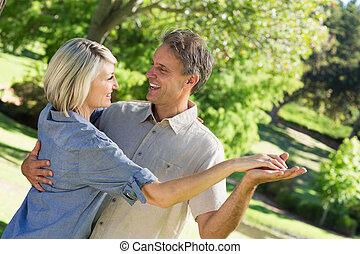 Couple dancing in park