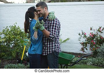 Couple dancing in the garden