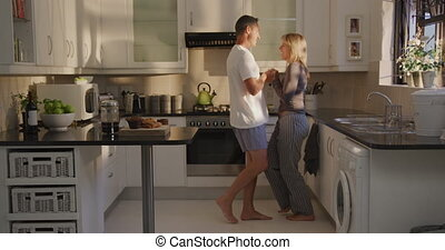 Couple dancing in their kitchen