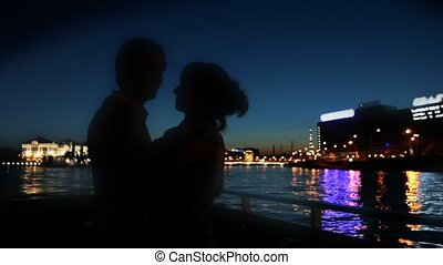 Couple dancing on ship sailing along Neva River at night