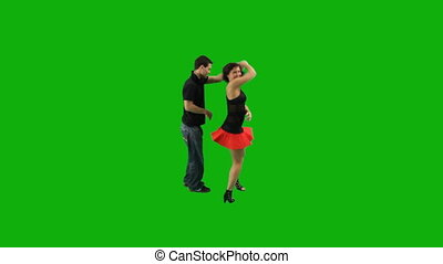 A couple dancing salsa against grey background. High angle.