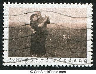 Couple Dancing Tango - FINLAND - CIRCA 1997: stamp printed...