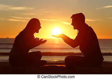 Couple dating falling in love at sunset - Portrait of a side...