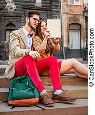 couple dating in city - Youngsmile couple sitting on stairs...