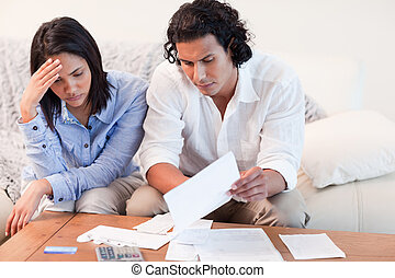 Couple depressed about financial problems - Young couple ...