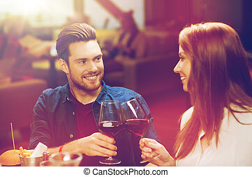 couple dining and drinking wine at restaurant - leisure,...