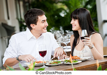Couple Dining Together - A young and attractive couple...