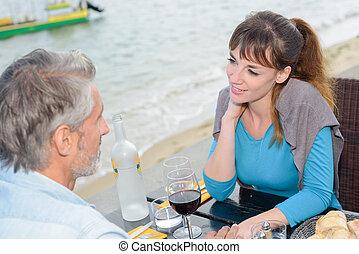 couple dinning alfresco