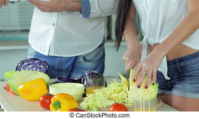 Couple discussing a new recipe for dinner on the tablet