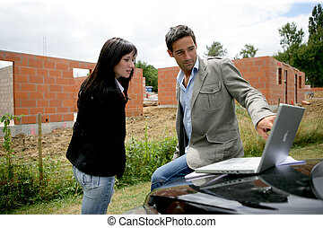 Couple discussing their plans for their new house