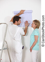 Couple discussing wallpaper