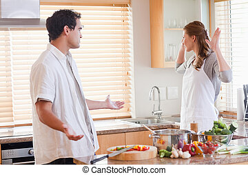 Couple disputing in the kitchen