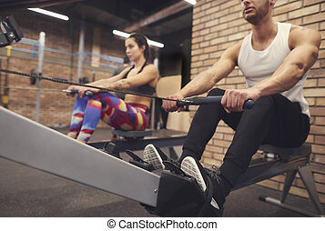 Couple doing crossfit training on the gym