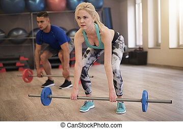 Couple doing dead lift together