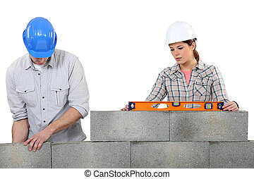 Couple doing masonry.