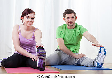 Couple doing pilates