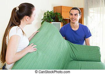 Couple doing relocation of furniture