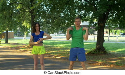 Couple doing stretching exercises before run
