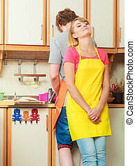 Couple doing the washing up in kitchen