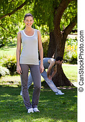 Couple doing their stretches in the park