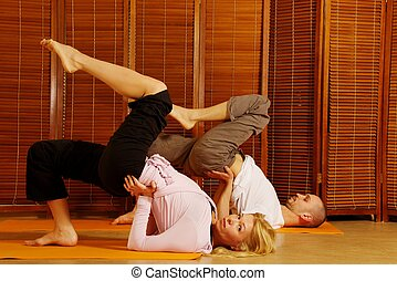 Couple doing yoga exercise