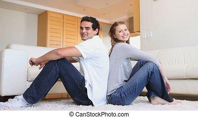 couple, dos, séance, plancher