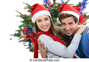 Couple dressed in festive hats