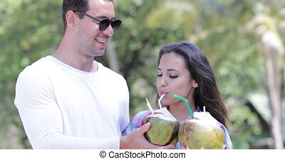 Couple Drink Coconut Cocktail Talking Over Palm Trees, Happy...