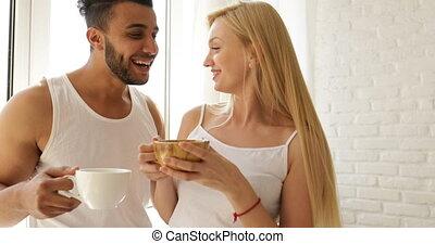 Couple drink coffee morning near window mix race man woman ...