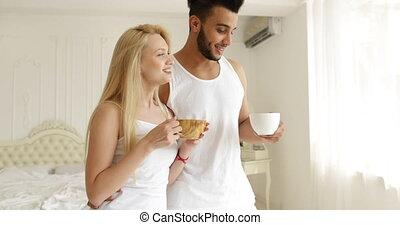 Couple drink coffee morning near window mix race man woman...
