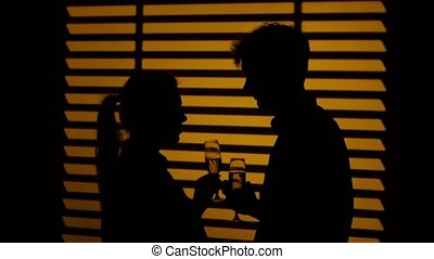 Couple drink wine. Silhouette. Close up