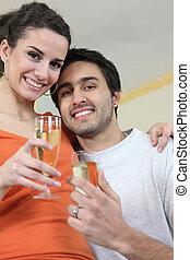 Couple drinking a celebratory drink